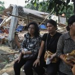 Members of congregation of Batak Christian Protestant Church sit near ruins of church after excavator demolished it in Taman Sari of Bekasi